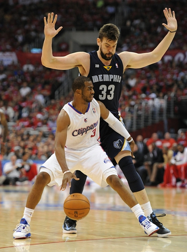 Apr 22, 2013; Los Angeles, CA, USA;  Memphis Grizzlies center Marc Gasol (33) guards Los Angeles Clippers point guard Chris Paul (3) in the second half of game one in the first round of the 2013 NBA playoffs at the Staples Center. Clippers won 93-91. Mandatory Credit: Jayne Kamin-Oncea-USA TODAY Sports
