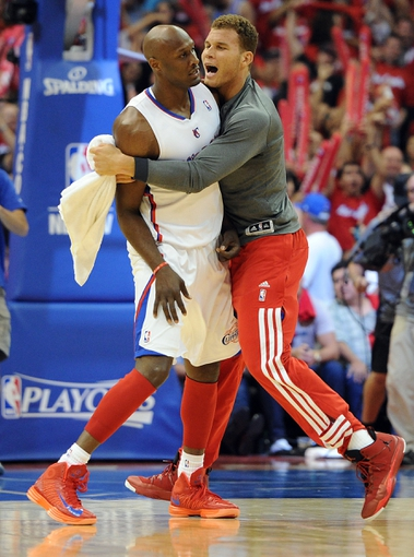 Apr 22, 2013; Los Angeles, CA, USA;  Los Angeles Clippers power forward Blake Griffin (32) celebrates with power forward Lamar Odom (7)  in the second half of game one against the Memphis Grizzlies  in the first round of the 2013 NBA playoffs at the Staples Center. Clippers won 93-91. Mandatory Credit: Jayne Kamin-Oncea-USA TODAY Sports