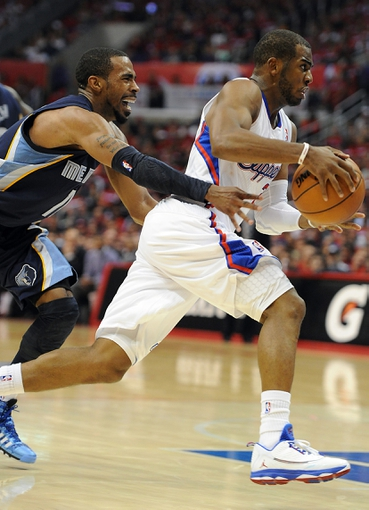 Apr 22, 2013; Los Angeles, CA, USA;  Memphis Grizzlies point guard Mike Conley (11) chases down Los Angeles Clippers point guard Chris Paul (3) in the second half of game one in the first round of the 2013 NBA playoffs at the Staples Center. Clippers won 93-91. Mandatory Credit: Jayne Kamin-Oncea-USA TODAY Sports