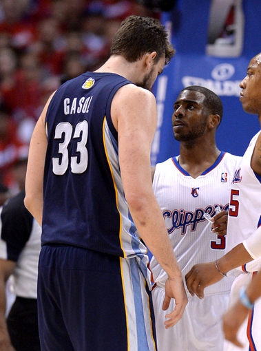 Apr 22, 2013; Los Angeles, CA, USA;  Los Angeles Clippers point guard Chris Paul (3) confronts Memphis Grizzlies center Marc Gasol (33) in the second half of game one in the first round of the 2013 NBA playoffs at the Staples Center. Clippers won 93-91. Mandatory Credit: Jayne Kamin-Oncea-USA TODAY Sports
