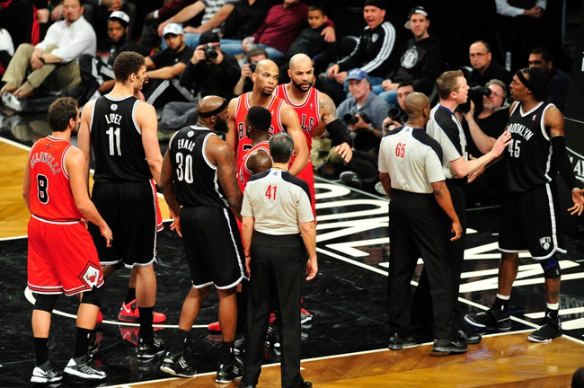 Apr 20, 2013; Brooklyn, NY, USA; Brooklyn Nets and Chicago Bulls argue after a foul during the second half of game one of the first round of the 2013 NBA Playoffs at the Barclays Center. The Nets won the game 106-89. Mandatory Credit: Joe Camporeale-USA TODAY Sports