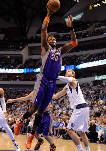 Apr 10, 2013; Dallas, TX, USA; Phoenix Suns center Jermaine O'Neal (20) shoots the ball over Dallas Mavericks power forward Dirk Nowitzki (41) at the American Airlines Center. The Suns defeated the Mavericks 102-91. Mandatory Credit: Jerome Miron-USA TODAY Sports
