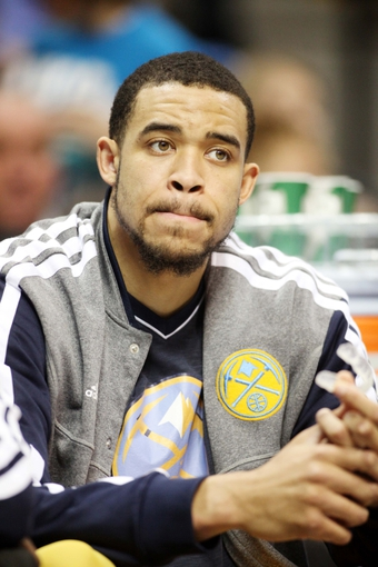 April 17, 2013; Denver, CO, USA; Denver Nuggets center JaVale McGee (34) on the bench during the first half against the Phoenix Suns at the Pepsi Center. Mandatory Credit: Chris Humphreys-USA TODAY Sports