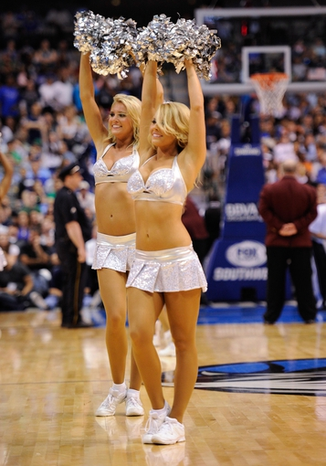 Apr 15, 2013; Dallas, TX, USA; The Dallas Mavericks dancers perform during a timeout in the game between the Mavericks and the Memphis Grizzlies at the American Airlines Center. Mandatory Credit: Jerome Miron-USA TODAY Sports