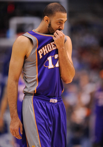 Apr 10, 2013; Dallas, TX, USA; Phoenix Suns point guard Kendall Marshall (12) takes the court to face the Dallas Mavericks during the game at the American Airlines Center. The Suns defeated the Mavericks 102-91. Mandatory Credit: Jerome Miron-USA TODAY Sports