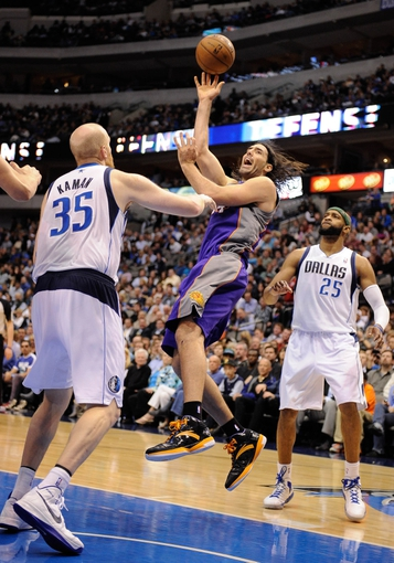 Apr 10, 2013; Dallas, TX, USA; Phoenix Suns power forward Luis Scola (14) shoots the ball over Dallas Mavericks center Chris Kaman (35) and shooting guard Vince Carter (25) at the American Airlines Center. The Suns defeated the Mavericks 102-91. Mandatory Credit: Jerome Miron-USA TODAY Sports