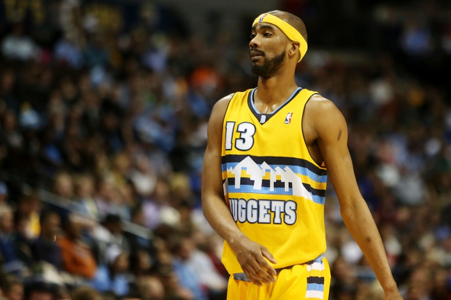 April 17, 2013; Denver, CO, USA; Denver Nuggets forward Corey Brewer (13) during the first half against the Phoenix Suns at the Pepsi Center. Mandatory Credit: Chris Humphreys-USA TODAY Sports