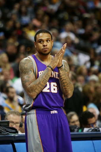 April 17, 2013; Denver, CO, USA; Phoenix Suns guard Shannon Brown (26) during the first half against the Denver Nuggets at the Pepsi Center.  The Nuggets won 118-98.  Mandatory Credit: Chris Humphreys-USA TODAY Sports