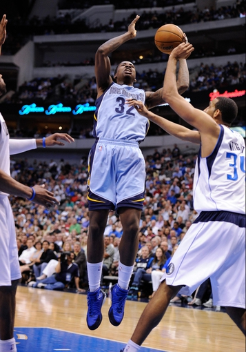 Apr 15, 2013; Dallas, TX, USA; Memphis Grizzlies power forward Ed Davis (32) shoots over Dallas Mavericks center Brandan Wright (34) during the game at the American Airlines Center. Mandatory Credit: Jerome Miron-USA TODAY Sports