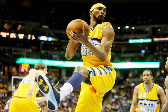 April 17, 2013; Denver, CO, USA; Denver Nuggets forward Corey Brewer (13) rebounds the ball during the first half against the Phoenix Suns at the Pepsi Center. Mandatory Credit: Chris Humphreys-USA TODAY Sports