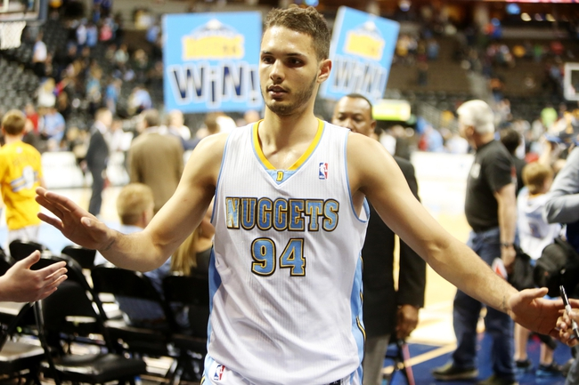 Apr 14, 2013; Denver, CO, USA; Denver Nuggets guard Evan Fournier (94) after the game against the Portland Trailblazers at the Pepsi Center. The Nuggets won 118-109.  Mandatory Credit: Chris Humphreys-USA TODAY Sports