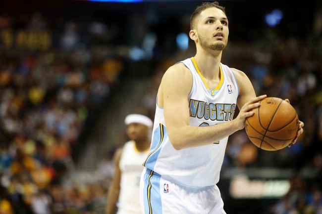 Apr 14, 2013; Denver, CO, USA; Denver Nuggets guard Evan Fournier (94) takes a free throw  during the second half against the Portland Trailblazers at the Pepsi Center. The Nuggets won 118-109.  Mandatory Credit: Chris Humphreys-USA TODAY Sports