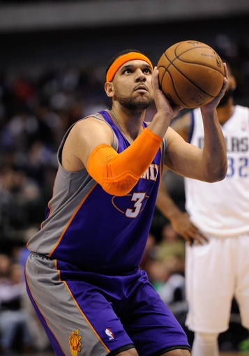 Apr 10, 2013; Dallas, TX, USA; Phoenix Suns shooting guard Jared Dudley (3) attempts a free throw during the game against the Dallas Mavericks at the American Airlines Center. The Suns defeated the Mavericks 102-91. Mandatory Credit: Jerome Miron-USA TODAY Sports