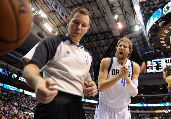 Apr 10, 2013; Dallas, TX, USA; Dallas Mavericks power forward Dirk Nowitzki (41) argues with referee Brian Forte (45) during the game against the Phoenix Suns at the American Airlines Center. The Suns defeated the Mavericks 102-91. Mandatory Credit: Jerome Miron-USA TODAY Sports
