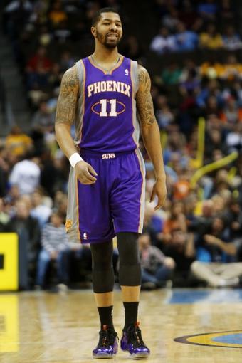 April 17, 2013; Denver, CO, USA; Phoenix Suns forward Markieff Morris (11) during the first half against the Denver Nuggets at the Pepsi Center.  The Nuggets won 118-98.  Mandatory Credit: Chris Humphreys-USA TODAY Sports