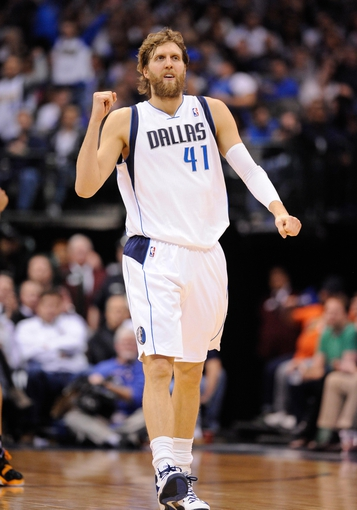 Apr 10, 2013; Dallas, TX, USA; Dallas Mavericks power forward Dirk Nowitzki (41) reacts after making a three point shot against the Phoenix Suns at the American Airlines Center. The Suns defeated the Mavericks 102-91. Mandatory Credit: Jerome Miron-USA TODAY Sports