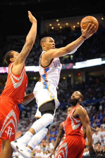 Apr 24, 2013; Oklahoma City, OK, USA; Oklahoma City Thunder guard Russell Westbrook (0) attempts a shot against Houston Rockets forward Greg Smith (4) in the second half during game two of the first round of the 2013 NBA Playoffs at Chesapeake Energy Arena. Mandatory Credit: Mark D. Smith-USA TODAY Sports