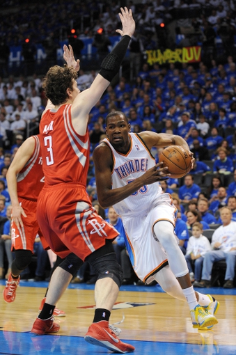 Apr 24, 2013; Oklahoma City, OK, USA; Oklahoma City Thunder forward Kevin Durant (35) handles the ball against Houston Rockets center Omer Asik (3) in the second half during game two of the first round of the 2013 NBA Playoffs at Chesapeake Energy Arena. Mandatory Credit: Mark D. Smith-USA TODAY Sports