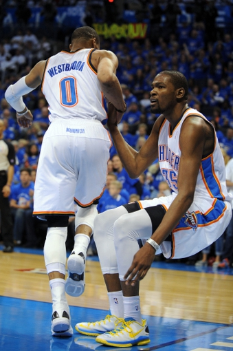 Apr 24, 2013; Oklahoma City, OK, USA; Oklahoma City Thunder forward Kevin Durant (35) is helped from the floor by Thunder guard Russell Westbrook (0) in action against the Houston Rockets in the second half during game two of the first round of the 2013 NBA Playoffs at Chesapeake Energy Arena. Mandatory Credit: Mark D. Smith-USA TODAY Sports