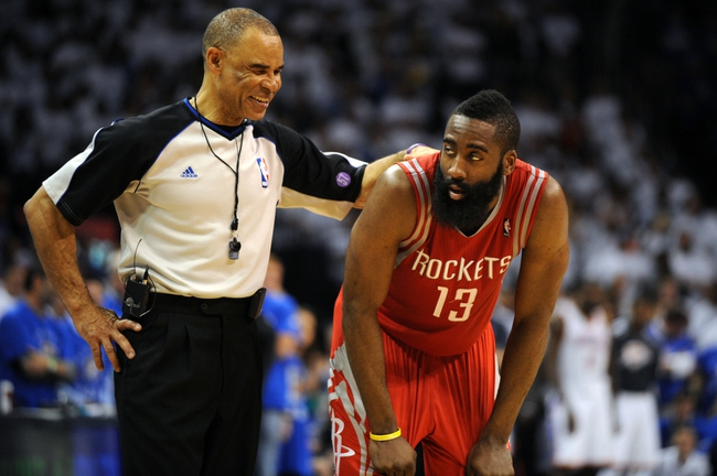 Apr 24, 2013; Oklahoma City, OK, USA; Houston Rockets guard James Harden (13) talks to NBA official Danny Crawford during a break in action in the second half during game two of the first round of the 2013 NBA Playoffs at Chesapeake Energy Arena. Mandatory Credit: Mark D. Smith-USA TODAY Sports