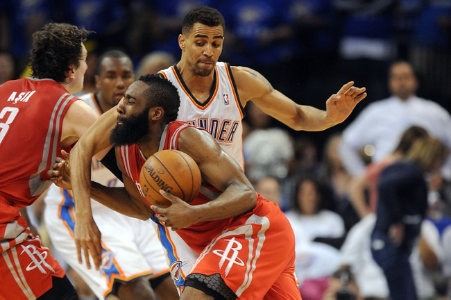 Apr 24, 2013; Oklahoma City, OK, USA; Houston Rockets guard James Harden (13) handles the ball against Oklahoma City Thunder guard Thabo Sefolosha (2) in the second half during game two of the first round of the 2013 NBA Playoffs at Chesapeake Energy Arena. Mandatory Credit: Mark D. Smith-USA TODAY Sports