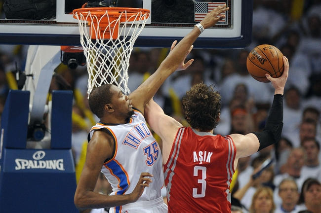 Apr 24, 2013; Oklahoma City, OK, USA; Houston Rockets center Omer Asik (3) attempts a shot against Oklahoma City Thunder forward Kevin Durant (35) in the second half during game two of the first round of the 2013 NBA Playoffs at Chesapeake Energy Arena. Mandatory Credit: Mark D. Smith-USA TODAY Sports