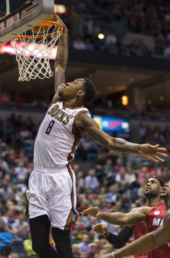 Apr 25, 2013; Milwaukee, WI, USA; Milwaukee Bucks center Larry Sanders (8) dunks during the third quarter of game three of the first round of the 2013 NBA playoffs against the Miami Heat at BMO Harris Bradley Center. Mandatory Credit: Jeff Hanisch-USA TODAY Sports
