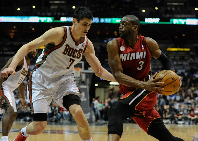 Apr 25, 2013; Milwaukee, WI, USA; Miami Heat guard Dwyane Wade drives for the basket against Milwaukee Bucks forward Ersan Ilyasova during game three of the first round of the 2013 NBA playoffs at BMO Harris Bradley Center. Mandatory Credit: Benny Sieu-USA TODAY Sports