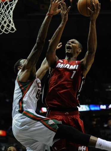 Apr 25, 2013; Milwaukee, WI, USA;  Miami Heat center Chris Bosh goes for a layup against Milwaukee Bucks' Larry Sanders during game three of the first round of the 2013 NBA playoffs at BMO Harris Bradley Center. Mandatory Credit: Benny Sieu-USA TODAY Sports