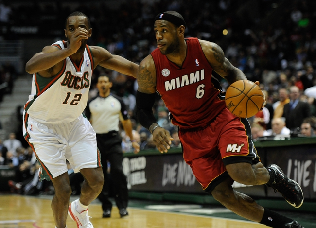 Apr 25, 2013; Milwaukee, WI, USA; Miami Heat forward LeBron James drives for the basket against Milwaukee Bucks forward Luc Richard Mbah a Moute during game three of the first round of the 2013 NBA playoffs at BMO Harris Bradley Center. Mandatory Credit: Benny Sieu-USA TODAY Sports