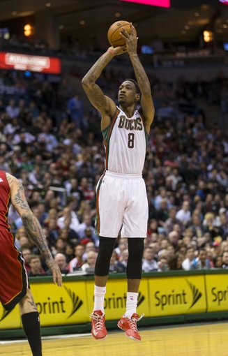 Apr 25, 2013; Milwaukee, WI, USA; Milwaukee Bucks center Larry Sanders (8) shoots during the fourth quarter of game three of the first round of the 2013 NBA playoffs against the Miami Heat at BMO Harris Bradley Center. Mandatory Credit: Jeff Hanisch-USA TODAY Sports