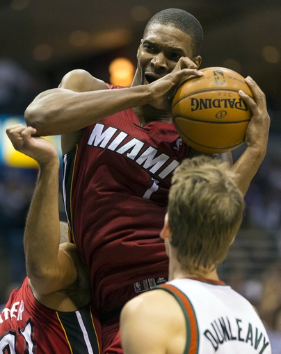 Apr 25, 2013; Milwaukee, WI, USA; Miami Heat center Chris Bosh (1) grabs a rebound during the fourth quarter of game three of the first round of the 2013 NBA playoffs against the Milwaukee Bucks at BMO Harris Bradley Center. Mandatory Credit: Jeff Hanisch-USA TODAY Sports
