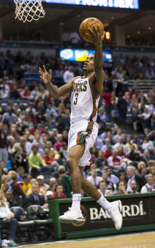 Apr 25, 2013; Milwaukee, WI, USA; Milwaukee Bucks guard Brandon Jennings (3) drives for a layup during the fourth quarter of game three of the first round of the 2013 NBA playoffs against the Miami Heat at BMO Harris Bradley Center. Mandatory Credit: Jeff Hanisch-USA TODAY Sports