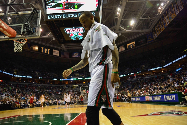 Apr 25, 2013; Milwaukee, WI, USA; Milwaukee Bucks guard Monta Ellis leaves the court after the Bucks lost to the Miami Heat during game three of the first round of the 2013 NBA playoffs at BMO Harris Bradley Center. Mandatory Credit: Benny Sieu-USA TODAY Sports