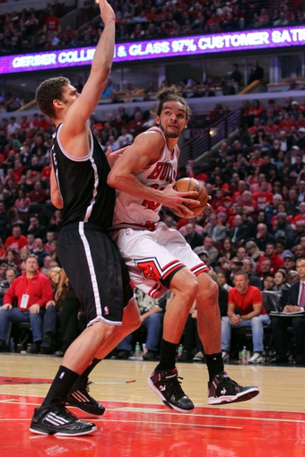 Apr 25, 2013; Chicago, IL, USA; Chicago Bulls center Joakim Noah (13) is defended by Brooklyn Nets center Brook Lopez (11) during the second quarter of the first round of the 2013 NBA playoffs at the United Center. Mandatory Credit: Dennis Wierzbicki-USA TODAY Sports