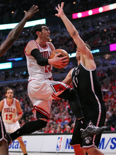 Apr 25, 2013; Chicago, IL, USA; Chicago Bulls shooting guard Kirk Hinrich (12) shoots against Brooklyn Nets center Brook Lopez (11) during the second quarter of the first round of the 2013 NBA playoffs at the United Center. Mandatory Credit: Dennis Wierzbicki-USA TODAY Sports