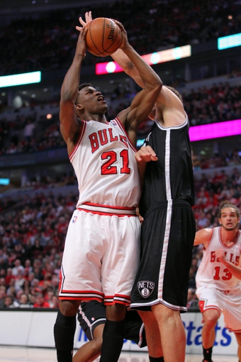 Apr 25, 2013; Chicago, IL, USA; Chicago Bulls small forward Jimmy Butler (21) drives against Brooklyn Nets center Brook Lopez (11)  during the second quarter of the first round of the 2013 NBA playoffs at the United Center. Mandatory Credit: Dennis Wierzbicki-USA TODAY Sports