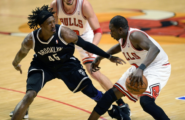 Apr 25, 2013; Chicago, IL, USA; Chicago Bulls small forward Luol Deng (9) dribbles the ball against Brooklyn Nets small forward Gerald Wallace (45) in the second half during game three of the first round of the 2013 NBA playoffs at the United Center. Chicago defeats Brooklyn 79-76. Mandatory Credit: Mike DiNovo-USA TODAY Sports