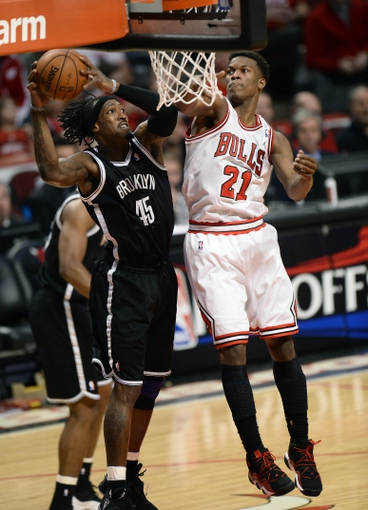 Apr 25, 2013; Chicago, IL, USA; Brooklyn Nets small forward Gerald Wallace (45) gets a rebound over Chicago Bulls small forward Jimmy Butler (21) in the second half during game three of the first round of the 2013 NBA playoffs at the United Center. Chicago defeats Brooklyn 79-76. Mandatory Credit: Mike DiNovo-USA TODAY Sports