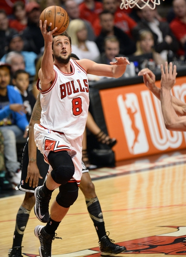 Apr 25, 2013; Chicago, IL, USA; Chicago Bulls shooting guard Marco Belinelli (8) shoots the ball against the Brooklyn Nets in the second half during game three of the first round of the 2013 NBA playoffs at the United Center. Chicago defeats Brooklyn 79-76. Mandatory Credit: Mike DiNovo-USA TODAY Sports