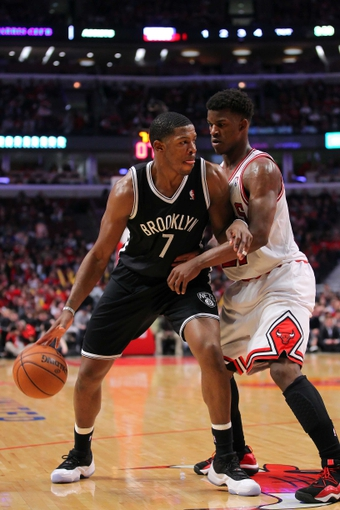 Apr 25, 2013; Chicago, IL, USA; Brooklyn Nets shooting guard Joe Johnson (7) is defended by Chicago Bulls small forward Jimmy Butler (21) during the second half of game three of the first round of the 2013 NBA playoffs at the United Center. Chicago won 79-76. Mandatory Credit: Dennis Wierzbicki-USA TODAY Sports