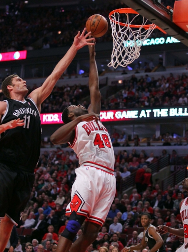Apr 25, 2013; Chicago, IL, USA; Chicago Bulls center Nazr Mohammed (48) shoots past Brooklyn Nets center Brook Lopez (11) during the second half of game three of the first round of the 2013 NBA playoffs at the United Center. Chicago won 79-76. Mandatory Credit: Dennis Wierzbicki-USA TODAY Sports