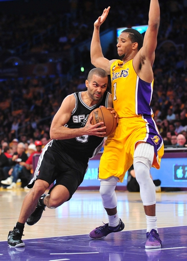 April 26, 2013; Los Angeles, CA, USA; San Antonio Spurs point guard Tony Parker (9) moves to the basket against the defense of Los Angeles Lakers point guard Darius Morris (1) during the second half in game three of the first round of the 2013 NBA playoffs at Staples Center. Mandatory Credit: Gary A. Vasquez-USA TODAY Sports