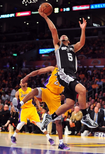 April 26, 2013; Los Angeles, CA, USA; San Antonio Spurs point guard Cory Joseph (5) scores a basket against the Los Angeles Lakers during the second half in game three of the first round of the 2013 NBA playoffs at Staples Center. Mandatory Credit: Gary A. Vasquez-USA TODAY Sports