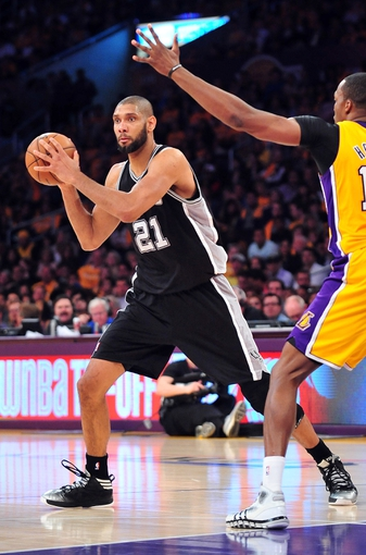 April 26, 2013; Los Angeles, CA, USA; San Antonio Spurs power forward Tim Duncan (21) controls the ball against the Los Angeles Lakers during the second half in game three of the first round of the 2013 NBA playoffs at Staples Center. Mandatory Credit: Gary A. Vasquez-USA TODAY Sports