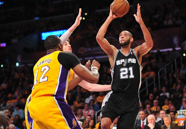 April 26, 2013; Los Angeles, CA, USA; San Antonio Spurs power forward Tim Duncan (21) shoots a basket against the Los Angeles Lakers during the second half in game three of the first round of the 2013 NBA playoffs at Staples Center. Mandatory Credit: Gary A. Vasquez-USA TODAY Sports