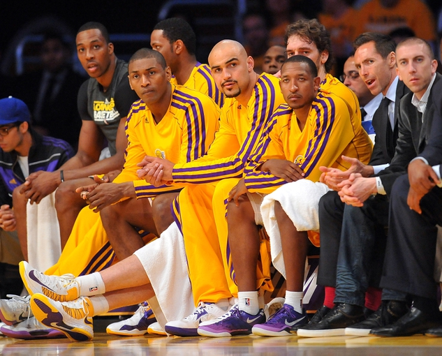 April 26, 2013; Los Angeles, CA, USA; Los Angeles Lakers  center Dwight Howard (12), small forward Metta World Peace (15), center Robert Sacre (50), small forward Earl Clark (6), point guard Steve Nash (10) and point guard Steve Blake (5) watch game action from the bench against the San Antonio Spurs during the second half in game three of the first round of the 2013 NBA playoffs at Staples Center. Mandatory Credit: Gary A. Vasquez-USA TODAY Sports