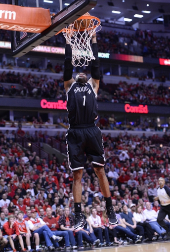 Apr 27, 2013; Chicago, IL, USA; Brooklyn Nets point guard C.J. Watson (1) dunks the ball against the Chicago Bulls in the second half during game four of the first round of the 2013 NBA playoffs at the United Center. Chicago defeats Brooklyn 142-134 in triple overtime. Mandatory Credit: Mike DiNovo-USA TODAY Sports