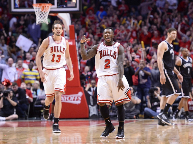 Apr 27, 2013; Chicago, IL, USA; Chicago Bulls point guard Nate Robinson (2) reacts after making a basket against the Brooklyn Nets in the closing seconds of the fourth quarter during game four of the first round of the 2013 NBA playoffs at the United Center. Chicago defeats Brooklyn 142-134 in triple overtime. Mandatory Credit: Mike DiNovo-USA TODAY Sports