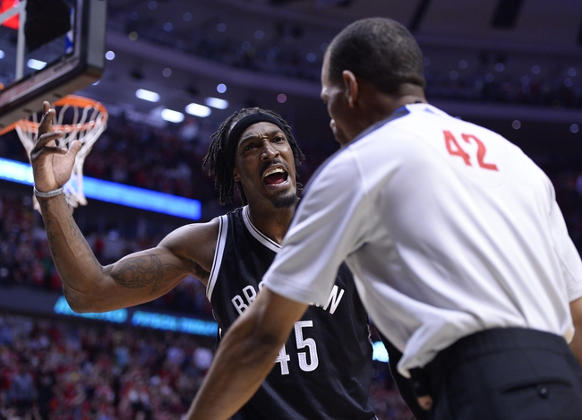 Apr 27, 2013; Chicago, IL, USA; Brooklyn Nets small forward Gerald Wallace (45) reacts to referee Brian Forte (45) after a play against the Chicago Bulls in the second half during game four of the first round of the 2013 NBA playoffs at the United Center. Chicago defeats Brooklyn 142-134 in triple overtime. Mandatory Credit: Mike DiNovo-USA TODAY Sports